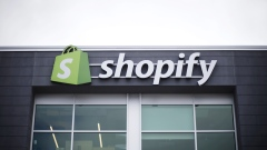 Signage is displayed at the Shopify Inc. office in Waterloo, Ontario, Canada, on Sept. 13, 2018. Shopify Plus, the company's highest-tiered subscription, is attracting migrations from other platforms. In 2Q, more than 50% of customers that were added to the service were new to the Shopify platform.