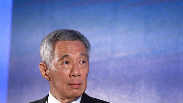 Lee Hsien Loong, Singapore's prime minister, pauses during a Q&A panel at a dinner in honor of the Bloomberg New Economy Forum on Tuesday, Nov. 6, 2018. The New Economy Forum, organized by Bloomberg Media Group, a division of Bloomberg LP, aims to bring together leaders from public and private sectors to find solutions to the world's greatest challenges. Photographer: Giulia Marchi/Bloomberg