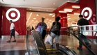 Shoppers walk towards a Target Corp. store at City Point in the Brooklyn borough of New York.