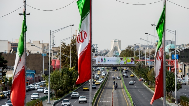 National flags of Iran fly above Azadi avenue in Tehran, Iran.in Tehran, Iran, on Saturday, Nov. 3, 2018. Iran's Supreme Leader Ayatollah Khamenei said U.S. President Donald Trump's policies are opposed by most governments and fresh sanctions on the Islamic Republic only serve to make it more productive and self-sufficient, the semi-official Iranian Students' News Agency reported.