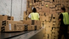Employees load a truck with boxes to be shipped at the Amazon.com Inc. distribution center in Phoenix, Arizona.
