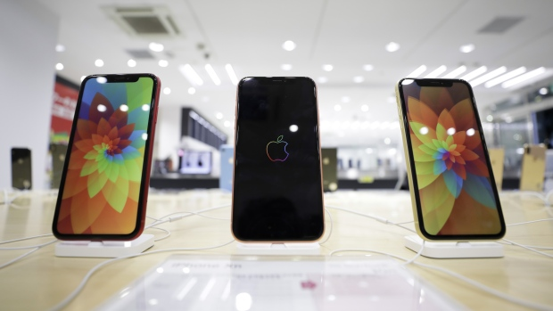 Apple Inc. iPhone XR smartphones sit on display at a Soft Bank Group Corp. store in Tokyo Japan on Friday Nov. 2 2018.        , Bloomberg