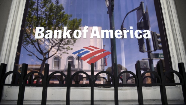 Buildings are reflected in the window of a Bank of America Corp. branch in Alameda California U.S. on Monday