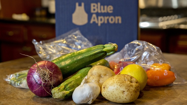 Vegetables from a Blue Apron Holdings Inc. meal-kit delivery are arranged for a photograph in Tiskilwa, Illinois, U.S., on Wednesday, June 14, 2017. Blue Apron Holdings Inc. filed for an initial public offering in the U.S., after reportedly delaying listing preparations while it worked to improve financials.