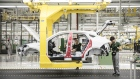 Employees assemble a Jaguar E-Pace compact sport utility vehicle (SUV) on the production line at the second phase of the Chery Jaguar Land Rover Automotive Co. plant in Changshu, China, on Wednesday, June 27, 2018.