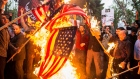 Iranians burn American flags during an anti-U.S. demonstration outside the former U.S. embassy headquarters in Tehran, Iran, on Wednesday, May 9, 2018. U.S. President Donald Trump pulled out of the 2015 deal that put limits on Iran's nuclear program in exchange for rapprochement with the West.