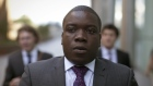 Kweku Adoboli, a former trader at UBS AG, leaves Southwark Crown Court after the court adjourned for lunch in London, U.K.