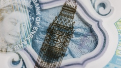 The Elizabeth Tower, also known as Big Ben, and a portrait of Queen Elizabeth II are seen on a British five pound banknote, in this arranged photograph in London, U.K., on Thursday, Oct. 13, 2016. The U.K. currency is getting harder to trade, and to predict, because the nation's exit from the European Union has changed the rules of engagement.