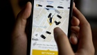 The Gett Inc. application is demonstrated for a photograph on an Apple Inc. iPhone in Washington, D.C., U.S., on Thursday, April 27, 2017. Two small ride-hailing companies are combining in an effort to slow the march of Uber Technologies Inc. around the globe. Tel Aviv-based Gett said its paying $200 million to acquire Juno, a New York startup that endeared itself to drivers by offering company stock and better pay than Uber.