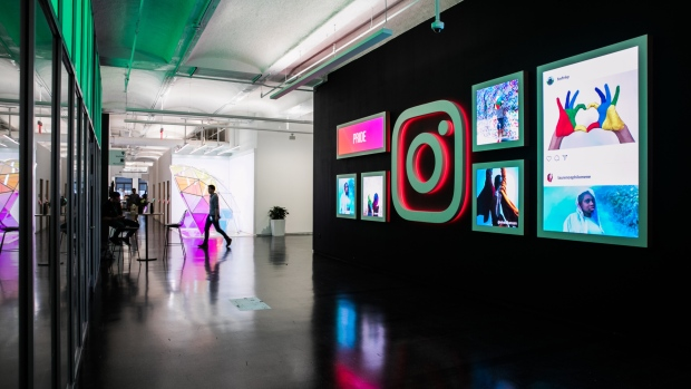 Signage and photographs are displayed at the Instagram Inc. office in New York, U.S.