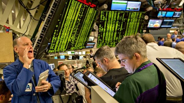 Traders work in the S&P 500 options pit at Cboe Global Markets Inc. in Chicago, Illinois, U.S., on Friday, Dec. 29, 2017. U.S. stocks slipped in thin trading on the final market day of 2017, while the dollars slump continued as the euro headed for its best annual performance in 14 years. The S&P 500 Index turned lower in trading 45 percent below the 30-day average, leaving its gain this year just under 20 percent, the most since 2013.
