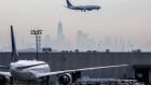 A United airplane prepares for landing as the New York City skyline stands in the background at Newark Liberty International Airport (EWR) in Newark, New Jersey, U.S., on Wednesday, April 12, 2017.