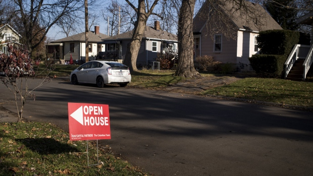 "An ""Open House"" sign is displayed in the front yard of a home for sale in Columbus, Ohio, U.S., on Sunday, Dec. 3, 2017. Photographer: Ty Wright/Bloomberg"