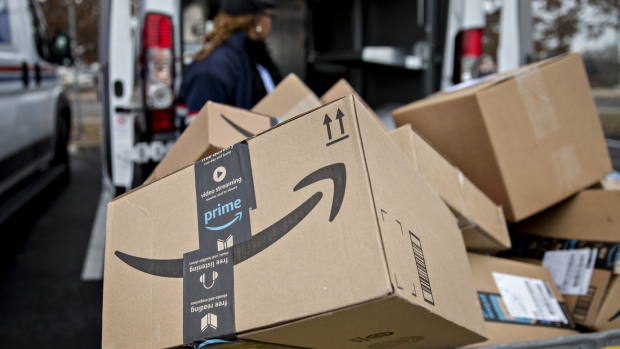 f8908353b6 An Amazon.com Inc. package sits in a bin before being placed on a