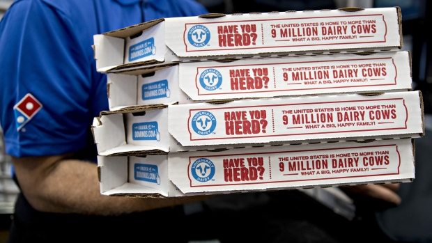 A employee moves pizza boxes before a delivery at a Domino's Pizza Inc. restaurant in Chantilly, Virginia, U.S., on Tuesday, Feb. 20, 2018. Domino's released earnings figures on February 20.