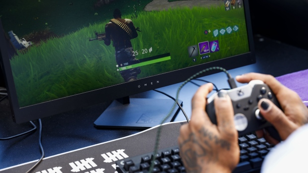An attendee plays in the Epic Games Inc. Fortnite: Battle Royale Celebrity Pro Am in Los Angeles on June 12, 2018.  Photographer: Patrick T. Fallon/Bloomberg