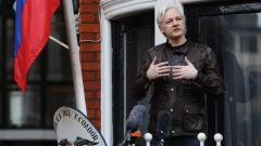Julian Assange speaks to media and supporters from a balcony at the Ecuadorian embassy in London on May 19, 2017.