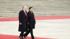 U.S. President Donald Trump, left, walks with Xi Jinping, China's president, during a welcome ceremony outside the Great Hall of the People in Beijing, China, on Thursday, Nov. 9, 2017.