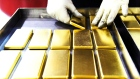 An employee arranges one kilogram gold bars at the Perth Mint Refinery, operated by Gold Corp., in Perth, Australia, on Thursday, Aug. 9, 2018. Demand for coins and minted bars was a little sluggish over the past year as Donald Trump's earlier win in the presidential poll prompted investors to divert funds into stocks, bonds and property, said Perth Mint's Chief Executive Officer Richard Hayes on Aug. 8.