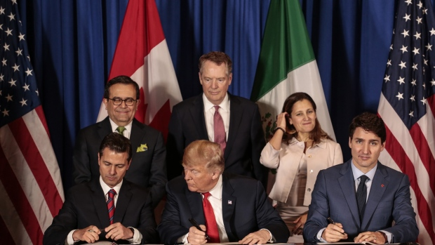 USMCA signed on Friday between the U.S., Canada and Mexico. Photographer: Sarah Pabst/Bloomberg