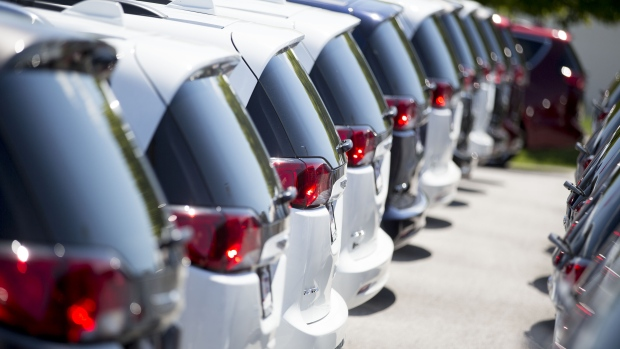 A row of Fiat Chrysler Automobiles (FCA) 2017 Crysler Pacifica minivan vehicles are displayed for sale at a car dealership in Moline, Illinois, U.S., ...
