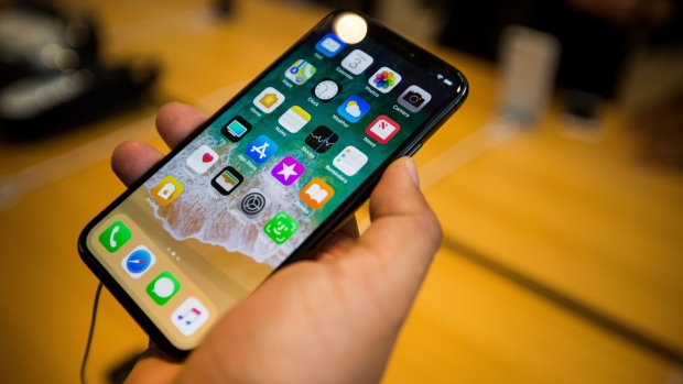 Apple said to consider moving iPhone output if tariffs hit 25% - BNNBloomberg.ca