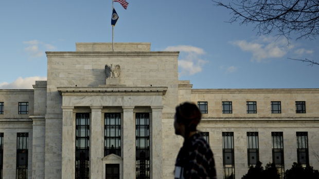 A pedestrian walks past the Marriner S. Eccles Federal Reserve building in Washington, D.C., U.S.
