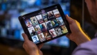 A selection of Netflix Inc. original content sits displayed in the Netflix app on an Apple Inc. iPad tablet device in this arranged photograph in London, U.K., on Monday, Aug. 20, 2018