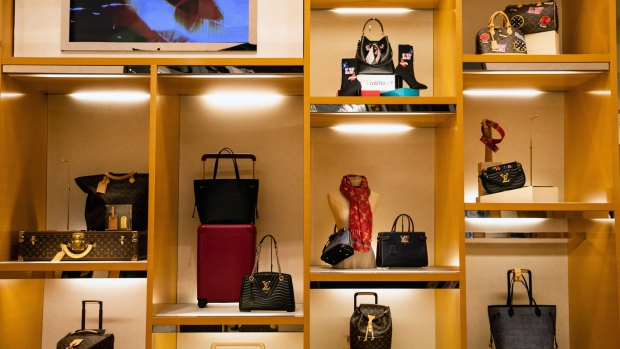 LVMH Moet Hennessy Louis Vuitton SE bags sit on display at the Macy's Inc. flagship store in New York, U.S., on Thursday, Nov. 22, 2018. Deloitte expects sales from November to January to rise as much as 5.6 percent, to more than $1.1 trillion, marking the best holiday period in recent memory.