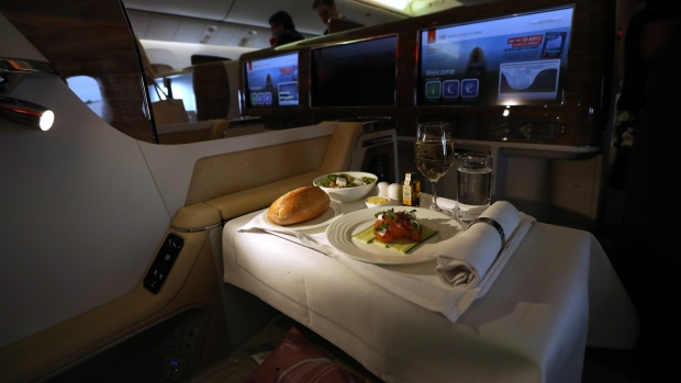 A meal sits on a travellers tray in the business class cabin on board a Boeing Co. 777-300ER passenger jetliner, operated by Emirates Airline, at London Stansted Airport in Stansted, U.K., on Friday, June 8, 2018. The arrival of the jetliner should kick off a new phase of growth for the terminal 35 miles north of London, according to London Stansted Airport Chief Executive Officer Ken O'Toole. Photographer: Chris Ratcliffe/Bloomberg