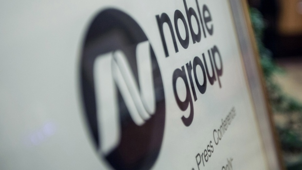 Noble Group Ltd. signage sits on display outside during an investor day in Singapore, on Monday, Aug. 17, 2015. Noble pledged to increase operating profit to more than $2 billion in the next three to five years as Asia\'s largest commodity trader sought to reassure investors about its long-term prospects.