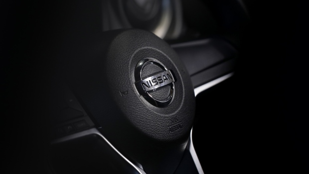 The Nissan Motor Co. badge is displayed on the steering wheel of a Note e-Power hybrid vehicle at the company's showroom in Yokohama, Japan, on Thursday, July 27, 2017. Nissan is counting on SUV models and the new Leaf to drive sales after first-quarter operating profit fell, hurt by higher incentive spending in the U.S.