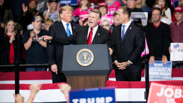 CHARLOTTE, NC - OCTOBER 26: Republican Congressional candidate for North Carolina's 9th district Mark Harris (C), addresses the crowd as President Donald Trump (L) and Republican Congressional candidate for North Carolina's 13th district Ted Budd (R), listen at the Bojangles Coliseum on October 26, 2018 in Charlotte, North Carolina. President Trump visited Charlotte to campaign for 9th District House candidate Mark Harris. (Photo by Sean Rayford/Getty Images)