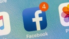 The Facebook Inc. application icon is displayed on an Apple Inc. iPhone in an arranged photograph taken in New York, U.S., on Thursday, July 26, 2018