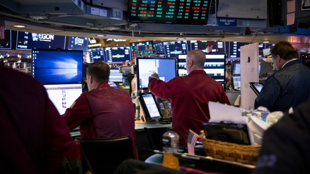 Traders work on the floor of the New York Stock Exchange (NYSE) in New York, U.S., on Friday, Dec. 7, 2018. U.S. stocks resumed their decline Friday as the Trump administration pressed its trade war with China and the latest batch of economic data added to concern that growth has peaked.