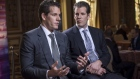 Cameron Winklevoss speaks as Tyler Winklevoss listens. Photographer: David Paul Morris/Bloomberg