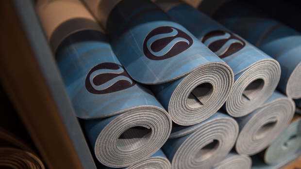 Yoga mats sit on display at the Lululemon Athletica Inc. sports apparel store on Regent Street in London, U.K., on Thursday, July 27, 2017. Lululemon is trying to attract more male customers and expand its presence overseas while competitors increase their reliance on discounts.