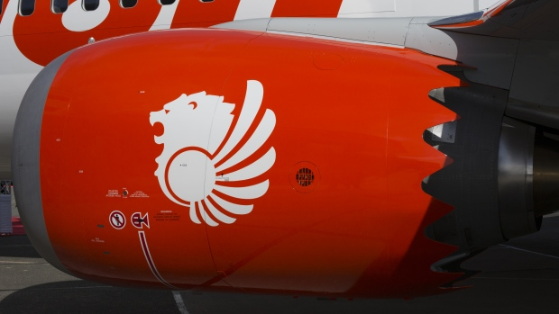 Lion Air Group livery is displayed on the engine of a Boeing Co. 737 Max 9.