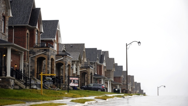 Homes for sale stand in East Gwillimbury, Ontario, Canada, on Friday, Nov. 2, 2018. STCA Canada is scheduled to release new housing price figures on Dec. 13.