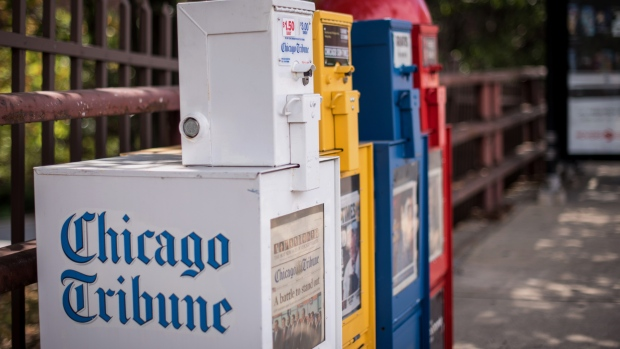 "A Chicago Tribune newspaper vending machine or ""honor box"" sits on a sidewalk in Chicago, Illinois, U.S., on Friday, Aug. 7, 2015."