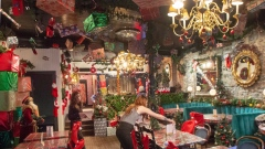Staff put the finishing touches on Christmas decorations at the Miracle Montreal bar