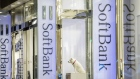 Signage for SoftBank Group Corp. is displayed outside a store in Tokyo, Japan, on Thursday, Nov. 29, 2018. SoftBank's 2.4 trillion yen ($21 billion) initial public offering of its Japanese telecommunications unit has successfully secured sales for the bulk of its shares to individual investors, people familiar with the matter said.