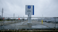 Signage stands on display outside the General Motors Co. transmission operation plant in Warren, Michigan.