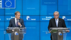 Donald Tusk, president of the European Union (EU), left, speaks beside Jean-Claude Juncker, president of the European Commission, during a news conference at a European Union (EU) leaders summit in Brussels, Belgium, on Friday, Dec. 14, 2018. European leaders rebuffed U.K. Prime Minister Theresa May's pleas to help her sell the Brexit agreement to a skeptical U.K. Parliament, toughening their stance as they stepped up planning for a chaotic no-deal divorce.