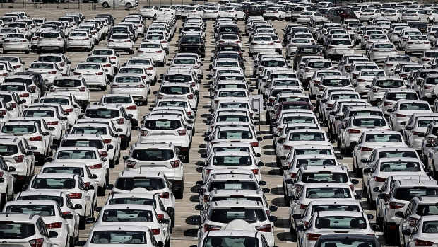 WUHAN, CHINA - JUNE 26: Thousands of cars part at the Wuhan Hannan port on the Yangtze River on June 26 ,2018 in Wuhan,Hubei province , China. Wuhan New Port comprises four ports in Hubei Province - Wuhan, Ezhou, Huanggang and Xianning. Yangluo Container Port is a major harbor in Wuhan, the capital city of central China's Hubei Province. It handles large amounts of containers and there are direct vessels from Wuhan New Port to Shanghai and onwards to the world every day. (Photo by Wang He/Getty Images)