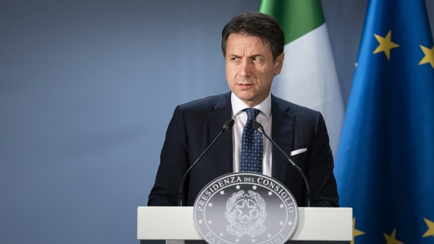 Giuseppe Conte, Italy's prime minister, pauses during a news conference at a European Union (EU) leaders summit in Brussels, Belgium, on Friday, Dec. 14, 2018. European leaders rebuffed U.K. Prime Minister Theresa May's pleas to help her sell the Brexit agreement to a skeptical U.K. Parliament, toughening their stance as they stepped up planning for a chaotic no-deal divorce. Photographer: Jasper Juinen/Bloomberg