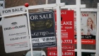 Real estate for sale signs are shown in Oakville, Ont., Dec. 1, 2018