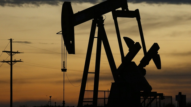 The silhouette of an electric oil pump jack is seen at dusk in the oil fields surrounding midland texas u s on tuesday nov 7 2017 nationwide gross oil refinery inputs will rise above 17 million barrels a day before the year ends according to energy aspects even amid a busy maintenance season and interruptions at plants in the u s gulf of mexico that were clobbered by hurricane harvey in the third quarter