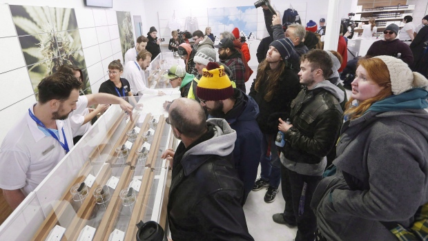 People check out the sample counter at a cannabis store in Winnipeg, Man., October 17, 2018