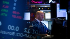 A trader works on the floor of the New York Stock Exchange (NYSE) in New York, U.S., on Friday, Dec. 14, 2018. Volatility continued to grip financial markets, with U.S. stocks erasing a weekly gain and Treasuries rising with the yen as mounting concern over the health of the global economy overshadowed positive trade developments and signs of strength in the American consumer.